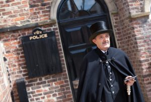 Costumed interpreter outside the Victorian Police Station
