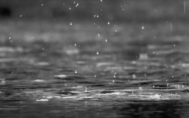 rain falling on water